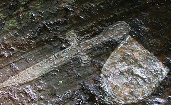 "The etchings in the rock today are nearly invisible. This is an ""enhanced photo"" showing what the sword and coat of arms probably looked like when made in 1398"