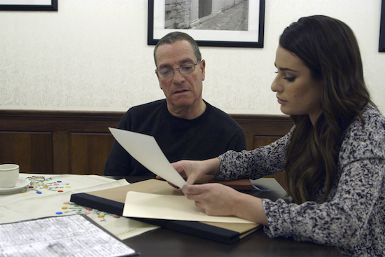 Lea shows a document to her father.